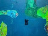unconnected amorphous shapes float on a blue sea.